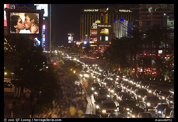 Congested foot and car traffic on Las Vegas Boulevard on Saturday night. Las Vegas, Nevada, USA (color)