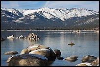 Boulders, kayak, and snowy mountains, Sand Harbor, Lake Tahoe-Nevada State Park, Nevada. USA