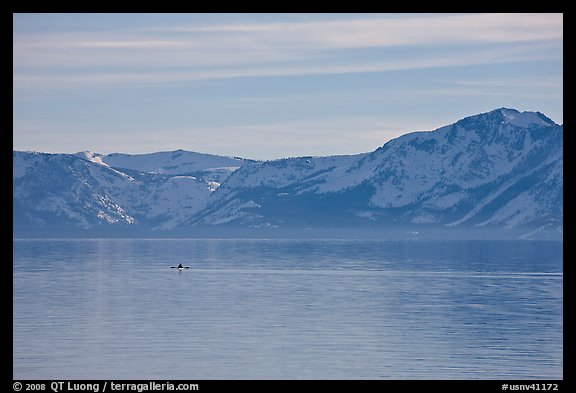 Kayak in the distance and mountains in winter, Lake Tahoe, Nevada. USA (color)