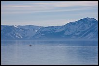 Kayak in the distance and mountains in winter, Lake Tahoe, Nevada. USA