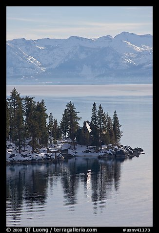 Cabin on lakeshore and snowy mountains, Lake Tahoe, Nevada. USA (color)
