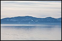 Distant mountains on lake rim in winter, Lake Tahoe, Nevada. USA