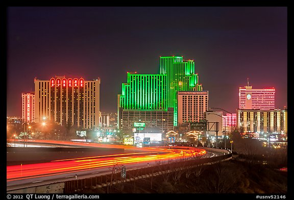 Illuminated casinos and freeway at night. Reno, Nevada, USA (color)