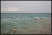 Families bathing in lake. Pyramid Lake, Nevada, USA (color)