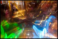 Fast moving lights and arcade game players. Reno, Nevada, USA (color)