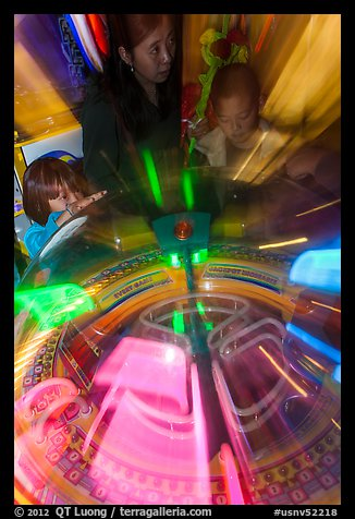 Arcade game light sweeps around players. Reno, Nevada, USA (color)