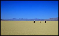 Three bicyclists on the desert Playa, Black Rock Desert. Nevada, USA