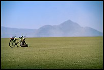 Bicyclist on the desert Playa, Black Rock Desert. Nevada, USA