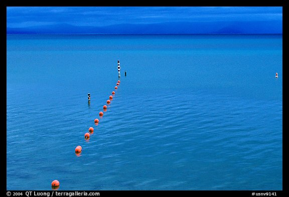 Buoy line and blue lake at dusk, South Lake Tahoe, California. USA (color)