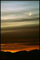 Crescent moon and mountain range. Nevada, USA