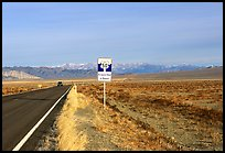 Sign reading Loneliest road in America. Nevada, USA (color)