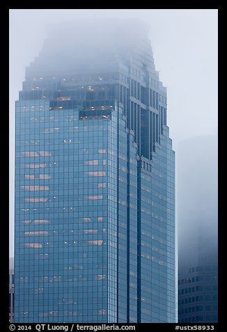 Top of skyscrapers capped in clouds. Houston, Texas, USA (color)