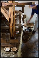 Man operating mill, Mission San Jose. San Antonio, Texas, USA ( color)