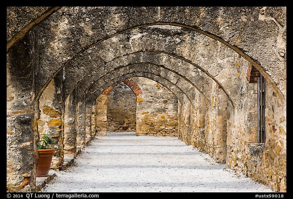 Arched walkway leading to the church, Mission San Jose. San Antonio, Texas, USA (color)