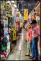 Man with cowboy hat and woman look at crafts, Market Square. San Antonio, Texas, USA ( color)