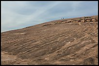 Granite dome with hikers, Enchanted Rock. Texas, USA ( color)