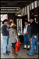 Group in front of White Elephant bar. Fort Worth, Texas, USA ( color)