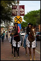 Women riding horses on sidewalk, Stockyards. Fort Worth, Texas, USA ( color)