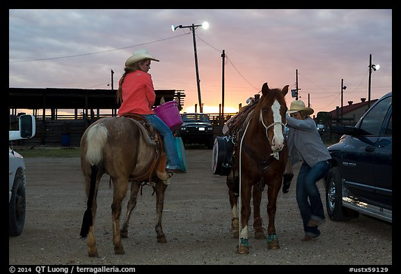 Women preparing to ride horses. Fort Worth, Texas, USA (color)