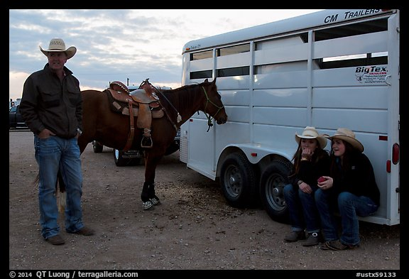 Group talking next to horse and trailer. Fort Worth, Texas, USA (color)