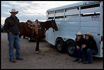 Group talking next to horse and trailer. Fort Worth, Texas, USA ( color)