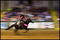 Woman riding horse in speed contest, Stokyards Championship Rodeo. Fort Worth, Texas, USA ( color)