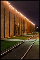 Railroad tracks and brick buildings at night, Stockyards. Fort Worth, Texas, USA ( color)