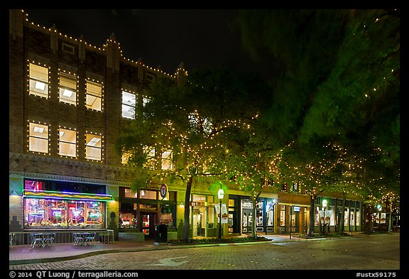 Street at night with lighted stores. Fort Worth, Texas, USA (color)