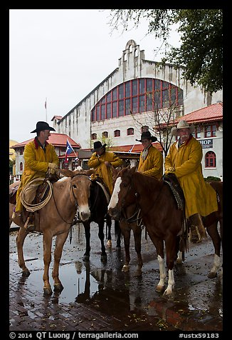 Cowboys in raincoats in front of Cowtown coliseum. Fort Worth, Texas, USA (color)