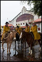 Cowboys in raincoats in front of Cowtown coliseum. Fort Worth, Texas, USA ( color)