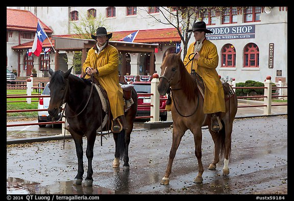 Cowboys in raincoats. Fort Worth, Texas, USA (color)