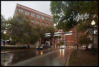 Elm Street with X marking JFK assassination spot and Texas School Book Depository,. Dallas, Texas, USA ( color)