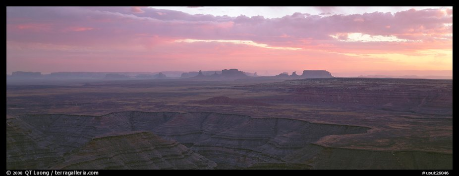 Sunset over canyon and distant mesas. Monument Valley Tribal Park, Navajo Nation, Arizona and Utah, USA (color)