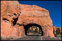 Road tunnel in pink limestone cliff. Utah, USA (color)