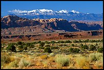 Sandstone cliffs and Henry mountains. Utah, USA