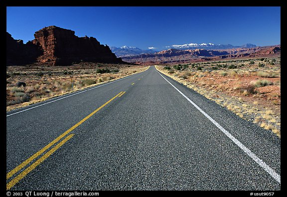 Road, sandstone cliffs, snowy mountains. Utah, USA (color)