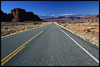 Road, sandstone cliffs, snowy mountains. Utah, USA ( color)