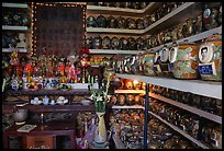 Temple room containing funeral urns with ashes of the deceased. Ho Chi Minh City, Vietnam