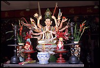 Altar with a multiple-armed buddhist statue. Ho Chi Minh City, Vietnam (color)