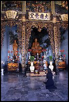 Woman praying at the altar. Ho Chi Minh City, Vietnam ( color)