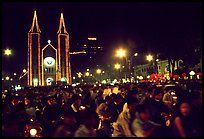 Crowds gather in front of the Cathedral St Joseph for Christmans. Ho Chi Minh City, Vietnam (color)