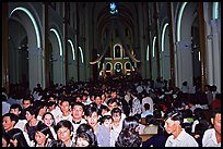 Crowds exit the Cathedral St Joseph at the end of the Christmas mass. Ho Chi Minh City, Vietnam