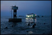 Lighted boat a dusk. Phu Quoc Island, Vietnam (color)