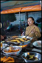 Woman preparing food, Dinh Cau Night Market. Phu Quoc Island, Vietnam (color)