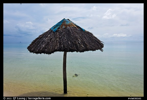 Sun shade in shallow beach water. Phu Quoc Island, Vietnam