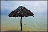 Sun shade in shallow beach water. Phu Quoc Island, Vietnam ( color)