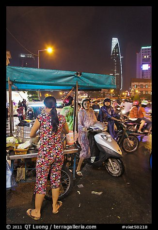 Street food stand at night. Ho Chi Minh City, Vietnam (color)