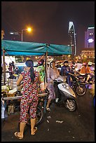 Street food stand at night. Ho Chi Minh City, Vietnam ( color)