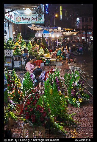 Flower and vegetable stores at night. Ho Chi Minh City, Vietnam (color)