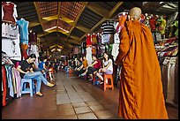 Buddhist Monk walking into Ben Thanh Market. Ho Chi Minh City, Vietnam
